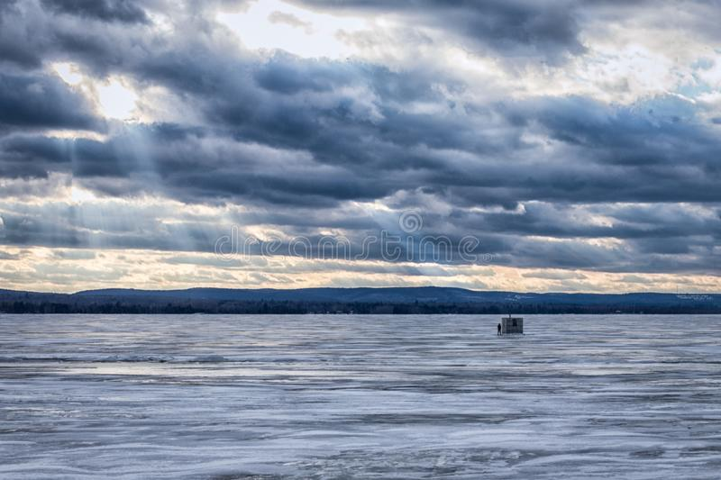 Lonely Ice Fisher royalty free stock images