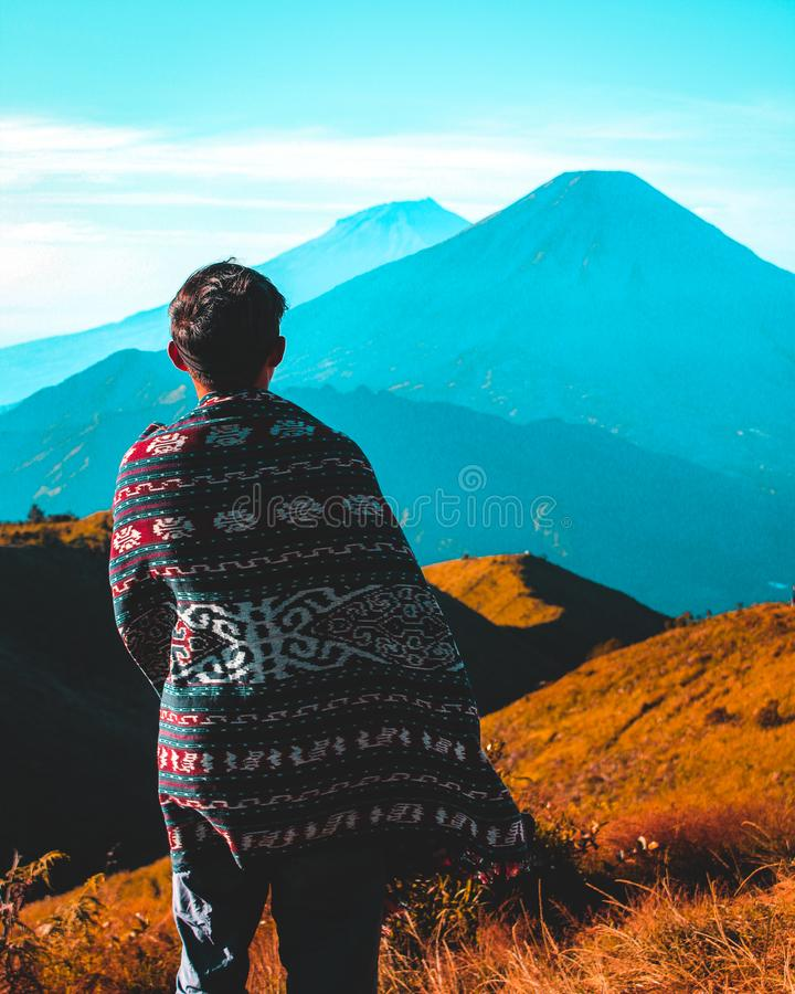 Person Staring at the Mountain stock photos