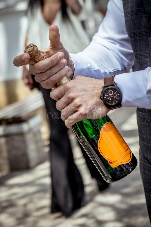 Opening a bottle of Champagne stock images