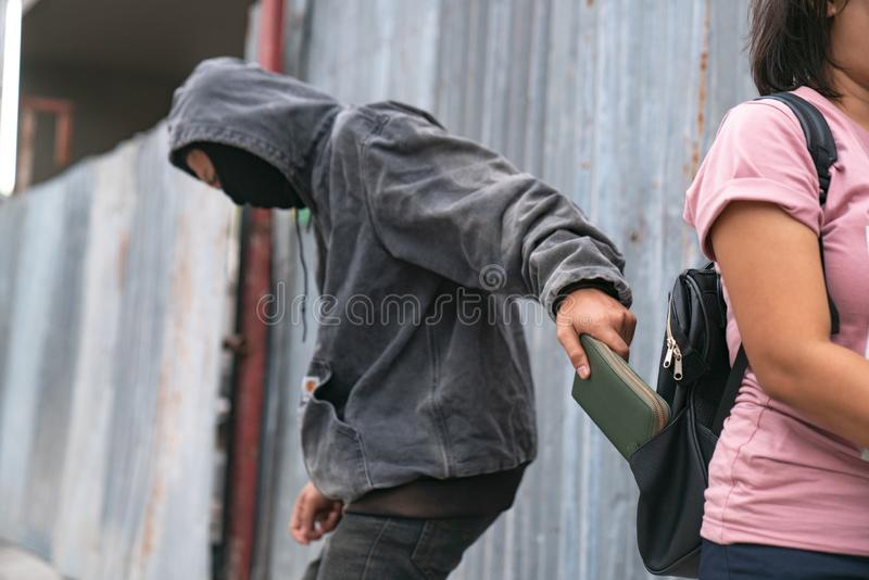 A Person Stealing Purse From Handbag stock image