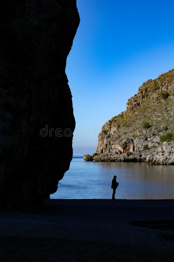 Person stone beach stock image