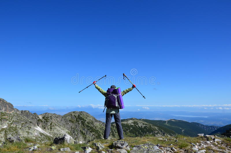 Person successful hiking at mountain peak. Person successful hiking in Rila Mountains in Bulgaria royalty free stock photography