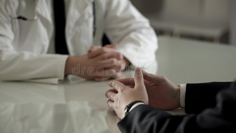 Person in suit at urologist appointment, private treatment of male diseases royalty free stock photo