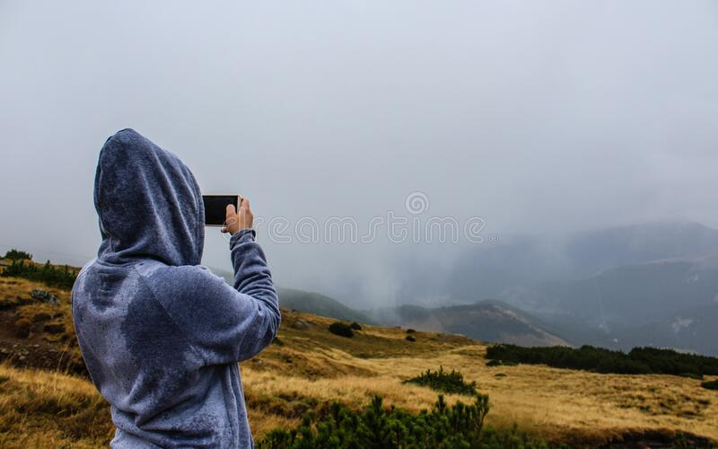 Person taking landscape panorama stock images