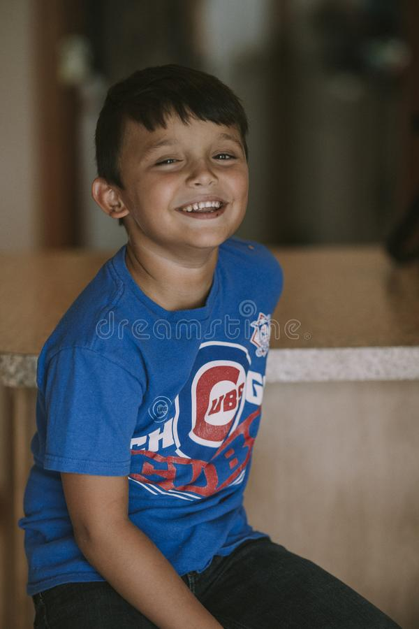 Person Taking Photo of Boy in Blue Chicago Cubs Crew-neck T-shirt in Tilt Shift Photography royalty free stock photos