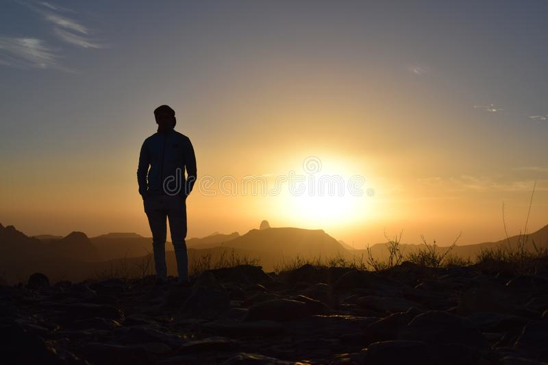 Person Taking Photo in Sunset stock image