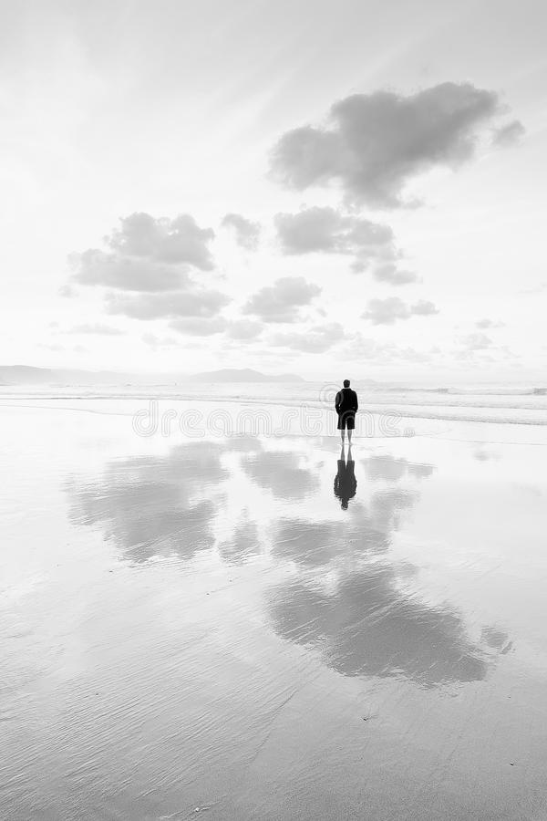Person thinking in the beach looking at sea royalty free stock photos