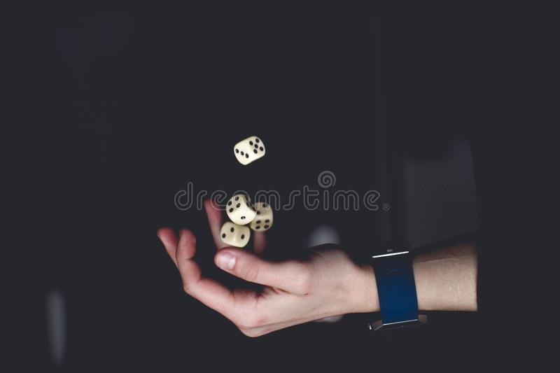 Person About to Catch Four Dices royalty free stock photography