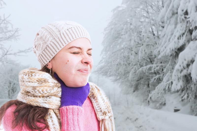 Person touching neck as flue or cold concept. Female person touching neck because of painful throat with hand wearing purple gloves as flue or cold concept in stock photo