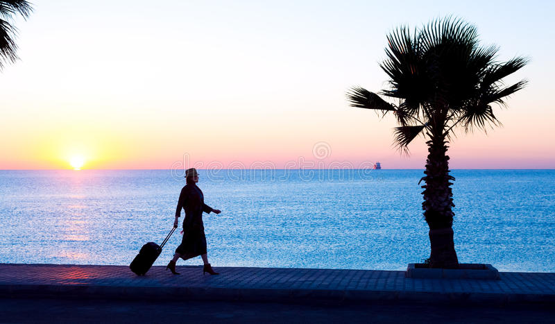 Person traveling Woman walking on Tropical Alley at Sunrise royalty free stock photo