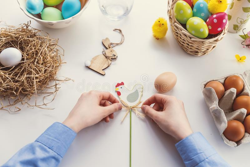 Person Tying Knot on Chicken Decor stock images