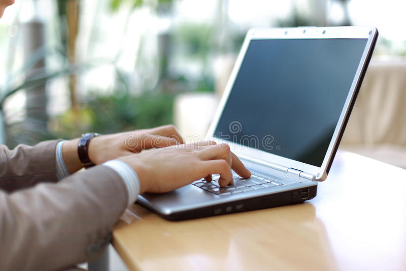 Person Typing on a modern stock image