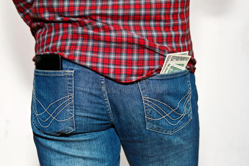Person with unsafe stick out from pocket money royalty free stock photos