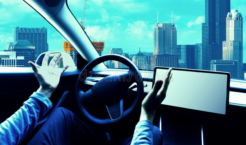 Person using a car in autopilot mode. Hands free stock photo