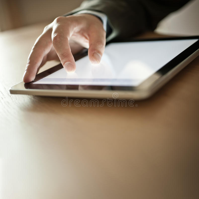 Person Using Modern Tablet Device. Businessman Using Modern Touchscreen Device royalty free stock photos