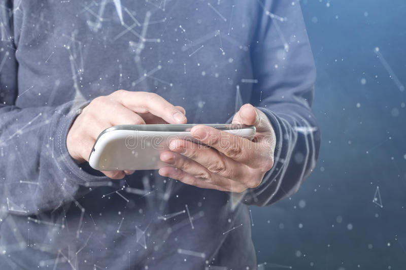 Person using a smart phone in deep web cyberspace. The cyber criminal person using a smart phone in deep web cyberspace. Selective focus royalty free stock photo