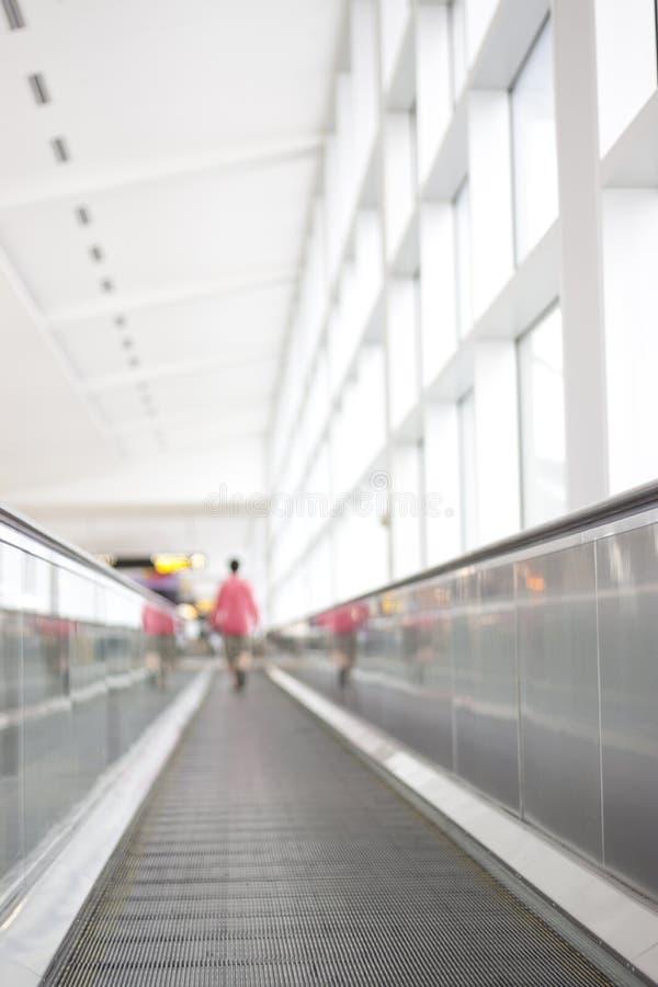 Free Person Walking Away On Airport Walkway Stock Photo - 16074600