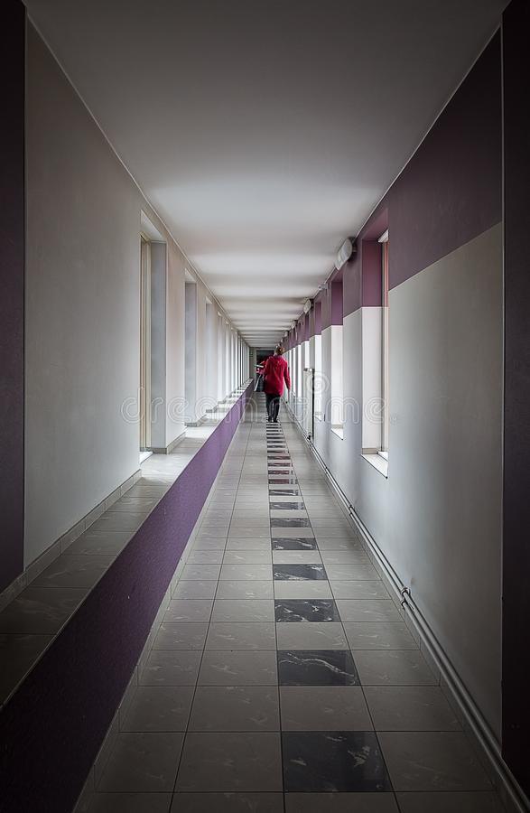 A person walking down the corridor royalty free stock photography
