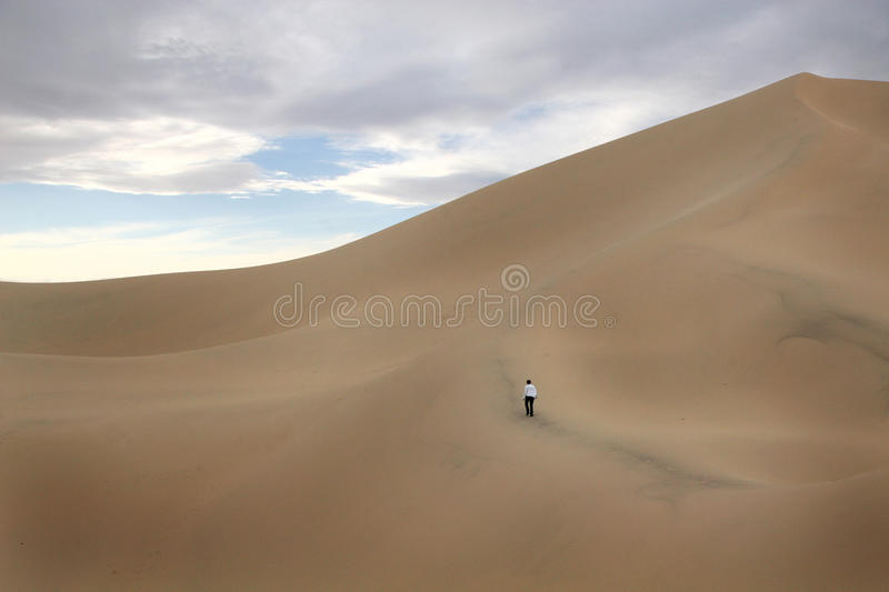 Download Person Walking On Large Sand Dune Editorial Image - Image of dune, work: 27615050