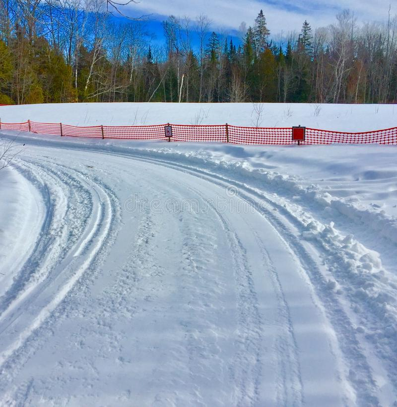 Snowmobile trail in secluded area with curve royalty free stock photo