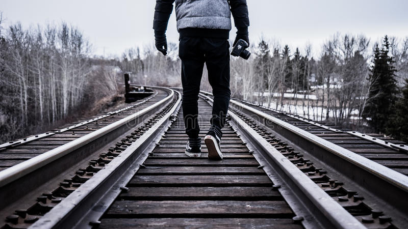 Person Walking On Railway During Day Time Free Public Domain Cc0 Image