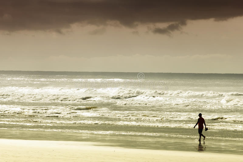 Person walking on sandy beach