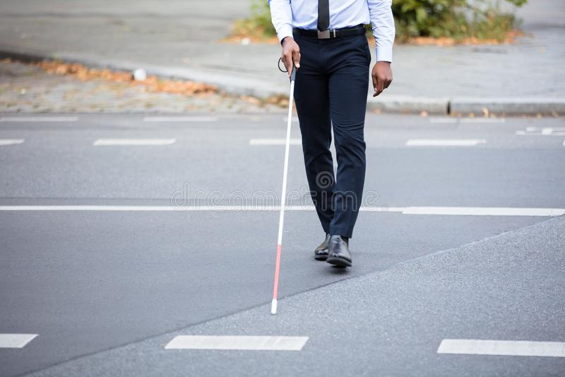 Person Walking On Street cego fotos de stock royalty free