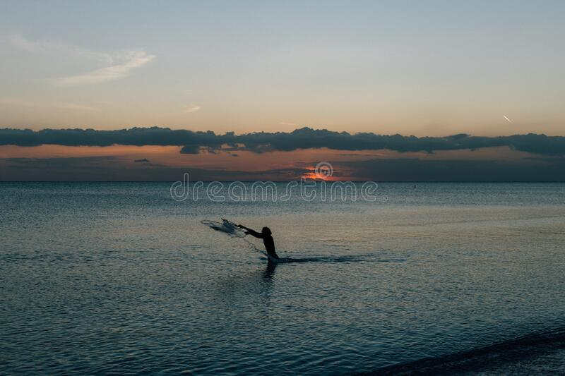 Person On Water Under Blue Sky During Daytime Free Public Domain Cc0 Image