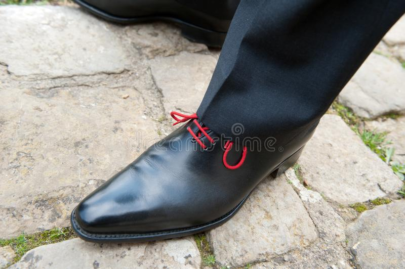 Person Wearing Black Leather Dress Shoes royalty free stock image