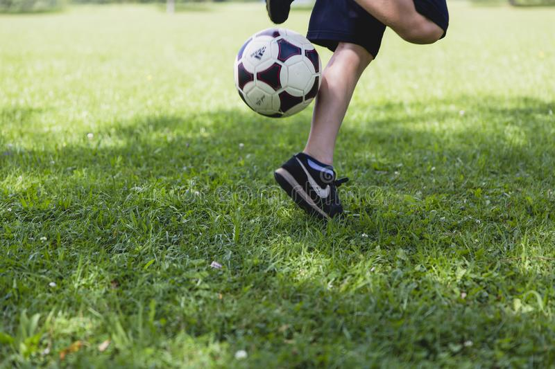 Person Wearing Black Nike Low-tops Sneakers Playing Soccer royalty free stock photo