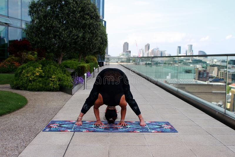 Person Wearing Black Tank Top Doing Yoga Position stock photos
