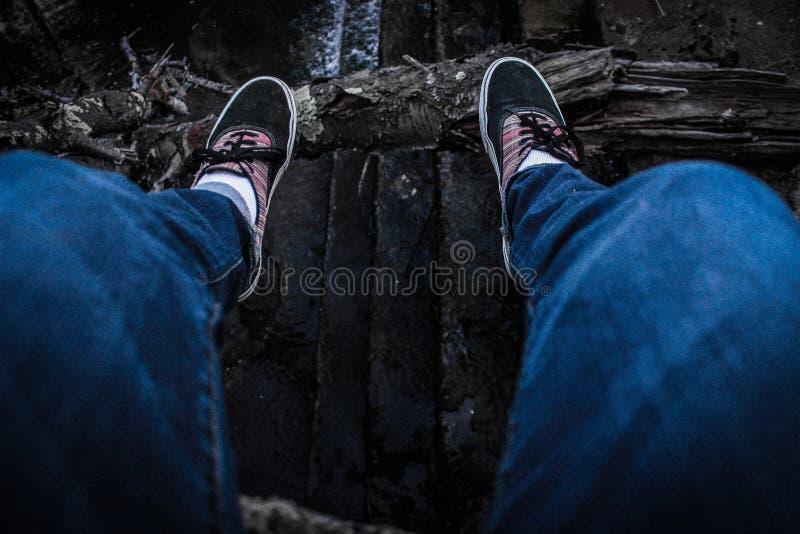Person Wearing Blue Denim Jeans Above Black Surface Free Public Domain Cc0 Image