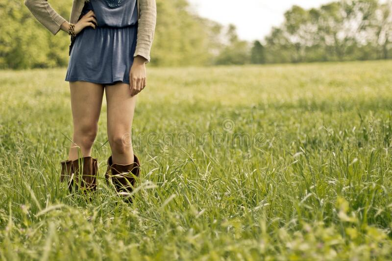 Person Wearing Brown Boots Standing On Green Grass Ground Free Public Domain Cc0 Image