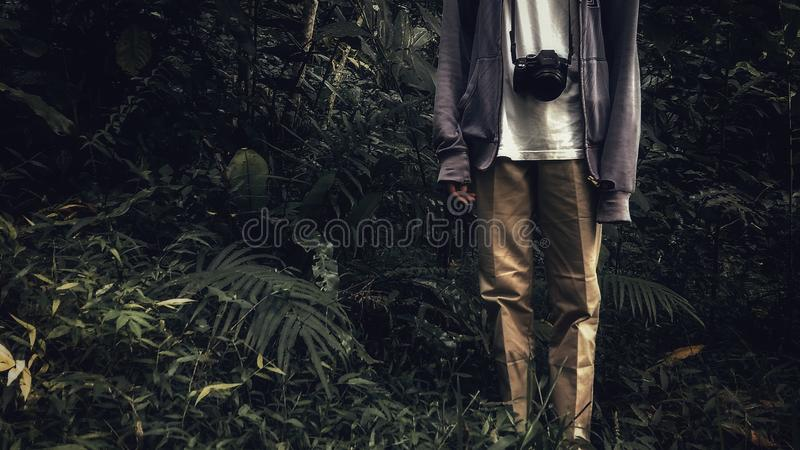 Person Wearing Brown Pants and Purple Jacket royalty free stock image