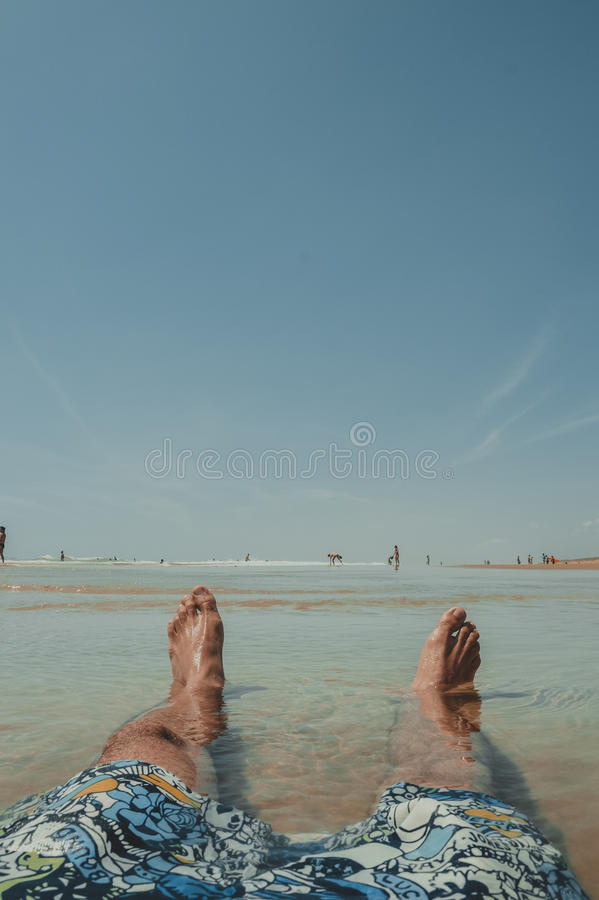Person Wearing Doodled Boardshorts Sitting On Surface With Water Free Public Domain Cc0 Image