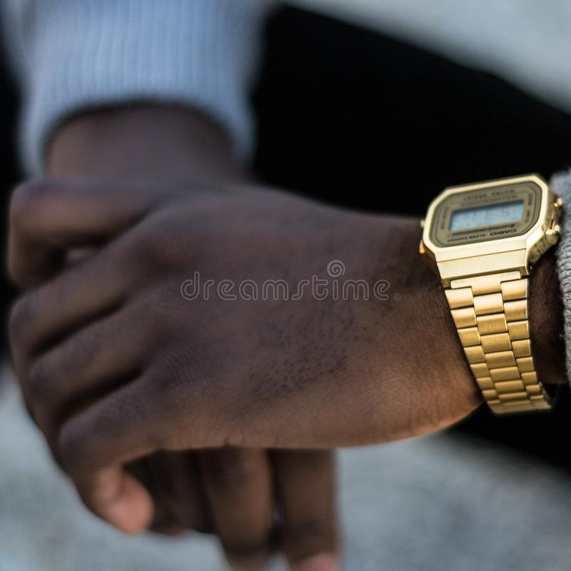 Person Wearing Gold-colored Casio Digital Watch With Linked Strap stock images