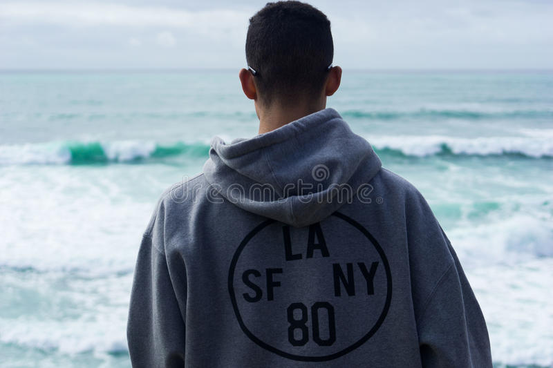 Person Wearing Gray Hoodie With La Sf Ny 80 Print Near Body Of Water During Daytime Free Public Domain Cc0 Image