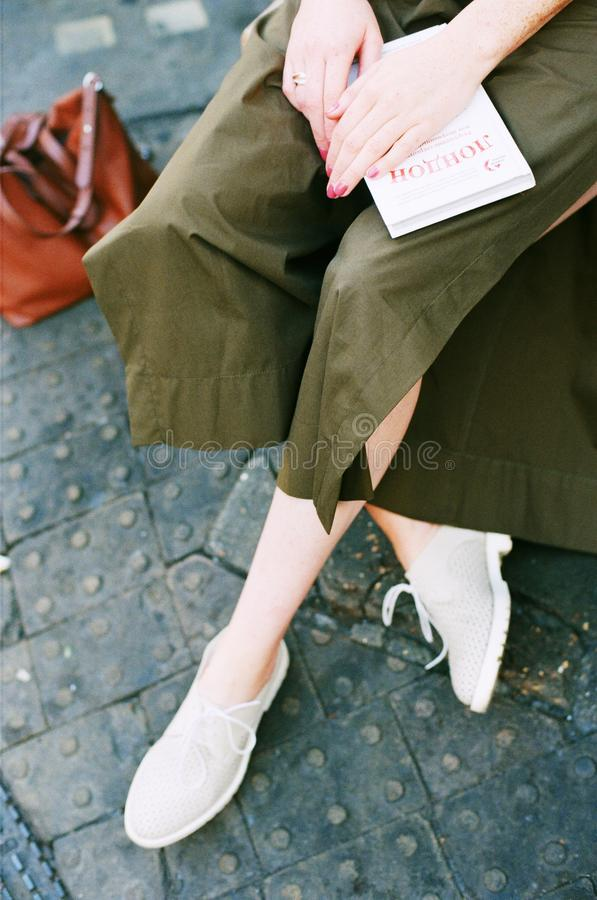 Person Wearing Green Skirt and Pair of White Low Top Sneakers stock photos