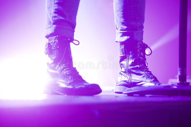 Person Wearing Lace Up Boots Standing On Stage Free Public Domain Cc0 Image