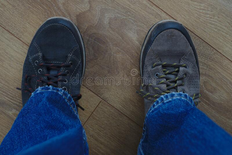 Person wearing Odd shoes. Man wearing odd shoes royalty free stock photography