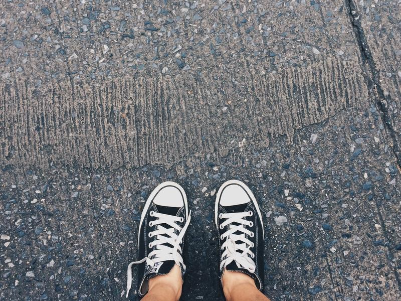 Person Wearing Pair of Black-and-white Converse All Star Low Sneakers royalty free stock photos