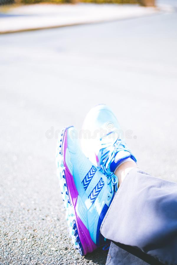 Person Wearing Pair of Blue-and-pink Running Shoes stock photo