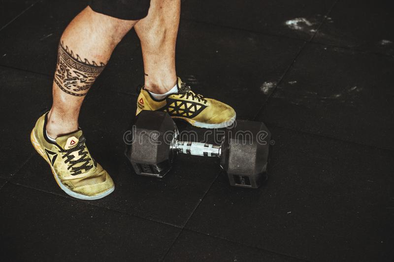 Person Wearing Pair of Gold-and-black Sneakers royalty free stock photos