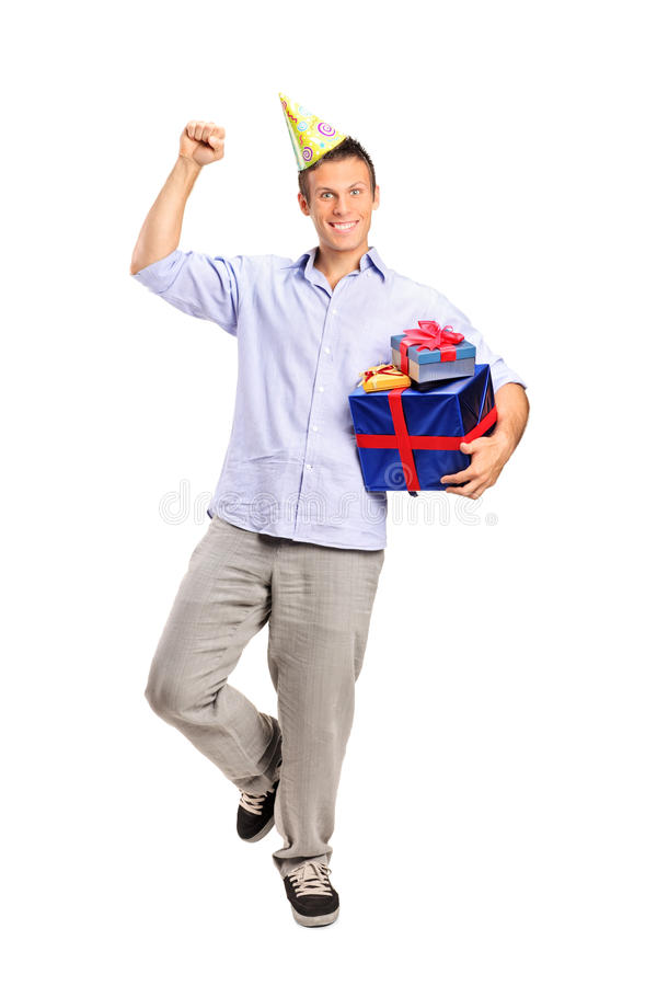 Download Person Wearing A Party Hat And Holding A Gift Stock Photo - Image: 20835992