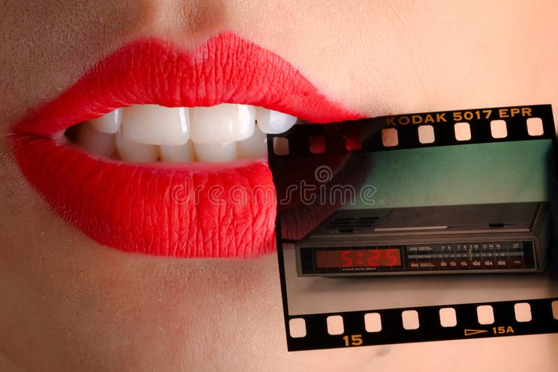 Person Wearing Red Lipstick Biting Film stock image