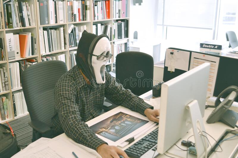 Person Wearing Scream Mask And Black Dress Shirt While Facing Computer Table During Daytime Free Public Domain Cc0 Image