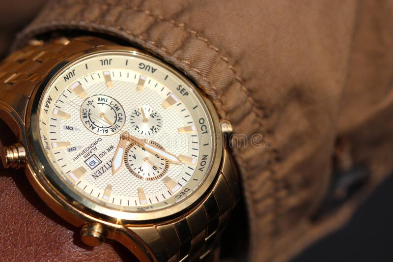 Person Wearing Silver Linked Chronograph Watch royalty free stock photos