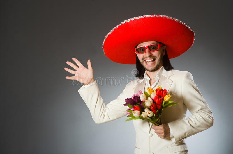 The person wearing sombrero hat in funny concept. Person wearing sombrero hat in funny concept stock photography