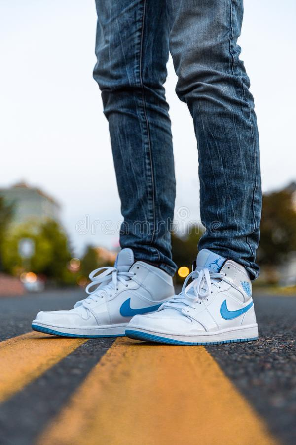 Person Wearing White And Blue Air Jordan 1's stock photos