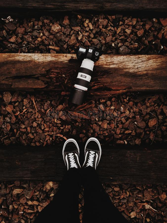 d6785637999 Person Wears Black-and-white Vans Low-top Sneakers Stands In Front ...